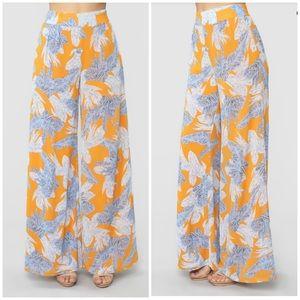 Fashion Nova Orange & blue tropical printed pants